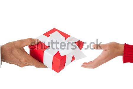 Couple passing a wrapped gift Stock photo © wavebreak_media