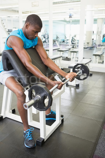определенный молодым человеком штанга спортзал вид сбоку Сток-фото © wavebreak_media