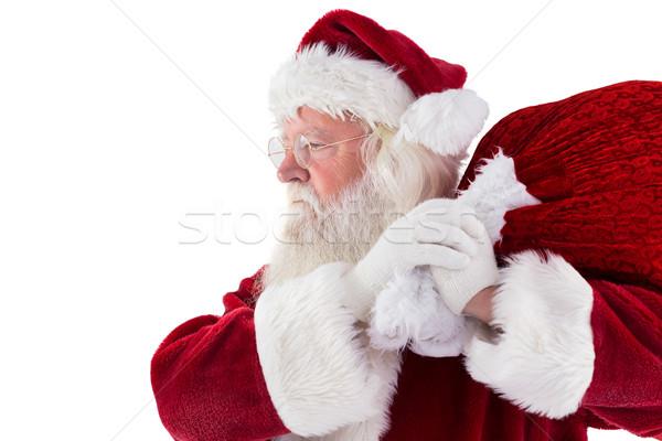 Santa carries his red bag Stock photo © wavebreak_media