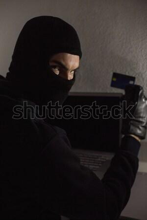 Hacker debitkártya laptop ház számítógép otthon Stock fotó © wavebreak_media