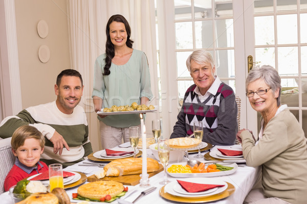 Woman holding christmas dinner with family at dinning table Stock photo © wavebreak_media