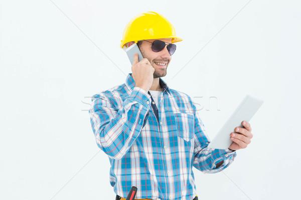 ács digitális tabletta mobiltelefon mosolyog fehér Stock fotó © wavebreak_media