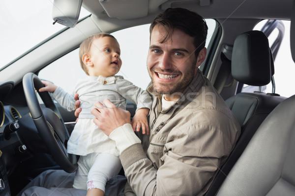Père jouer bébé siège voiture amusement Photo stock © wavebreak_media