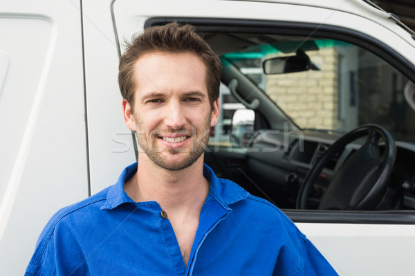 Stock photo: Smiling man in front of delivery van