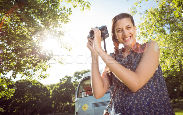 Pretty hipster taking a photo Stock photo © wavebreak_media