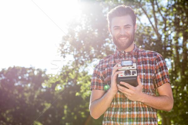 Handsome hipster holding vintage camera Stock photo © wavebreak_media