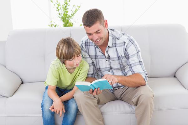 отец чтение история мальчика диван счастливым Сток-фото © wavebreak_media