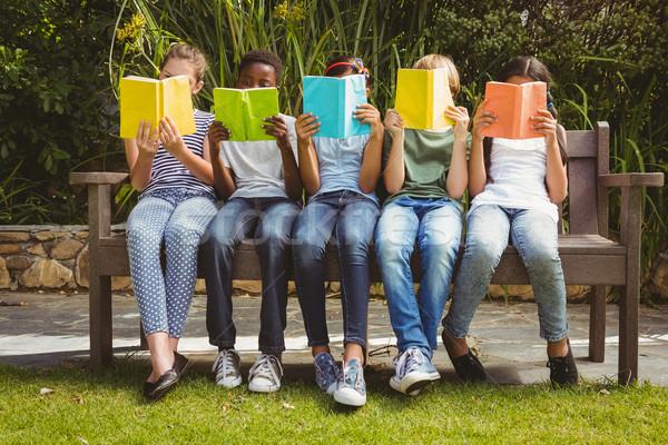 Children reading books at park Stock photo © wavebreak_media