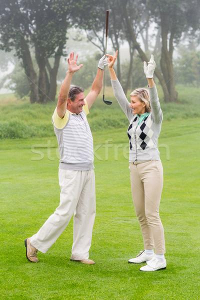Izgatott golfozás pár éljenez ködös nap Stock fotó © wavebreak_media