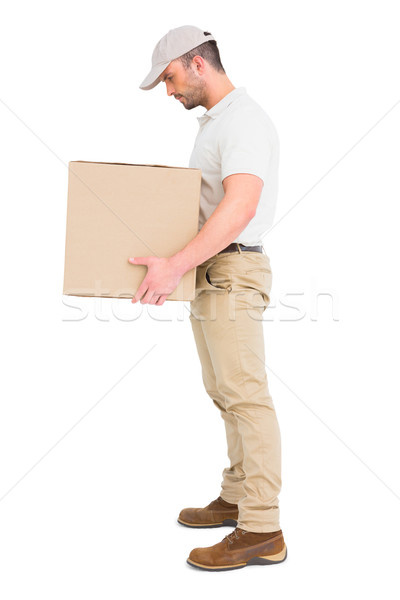 Delivery man carrying package Stock photo © wavebreak_media