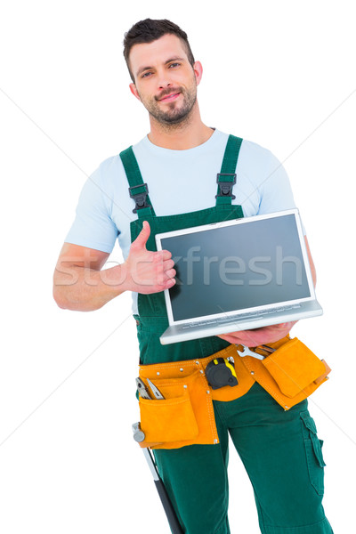 Smiling construction worker holding laptop Stock photo © wavebreak_media