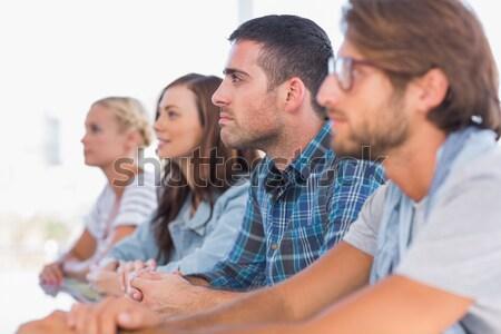 Equipo de negocios sesión línea escuchar reunión oficina Foto stock © wavebreak_media