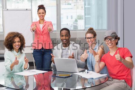 случайный бизнес-команды заседание улыбаясь камеры служба Сток-фото © wavebreak_media