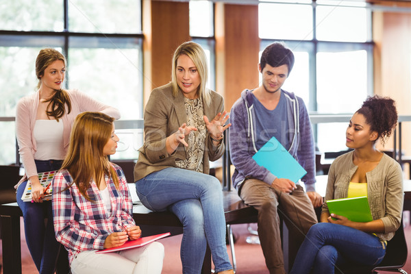 Mutlu Öğrenciler konuşma öğretmen kütüphane kitap Stok fotoğraf © wavebreak_media