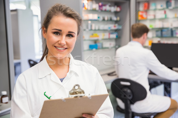 Pharmacy intern smiling at camera Stock photo © wavebreak_media