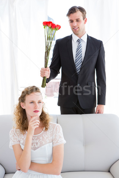 Happy businessman giving roses to his girlfriend Stock photo © wavebreak_media