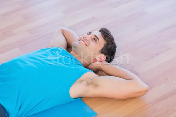 Smiling man lying on exercise mat  Stock photo © wavebreak_media