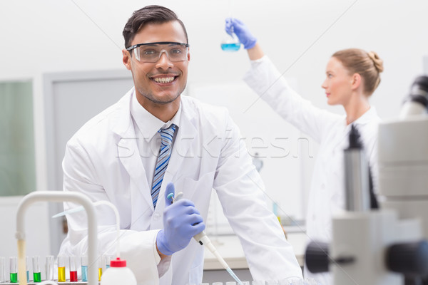 Scientists examining tubes and baker   Stock photo © wavebreak_media