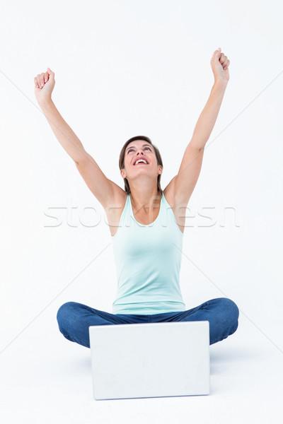 興奮した 女性 ノートパソコン 腕 白 コンピュータ ストックフォト © wavebreak_media