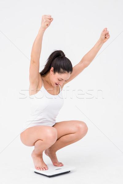 Gyönyörű nő éljenez mérleg fehér nő boldog Stock fotó © wavebreak_media