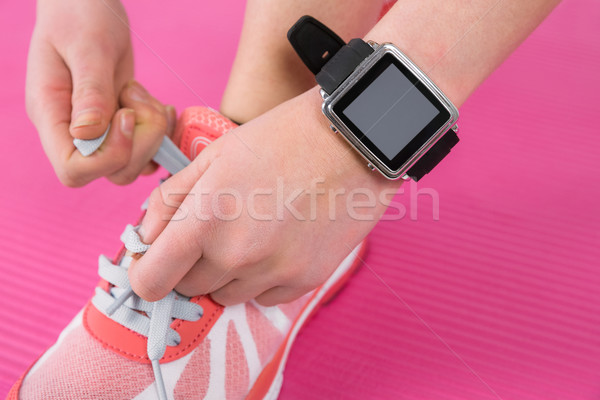 Woman tying her laces of sport shoes Stock photo © wavebreak_media