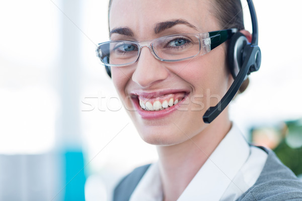 Happy businesswoman looking at camera with headset  Stock photo © wavebreak_media