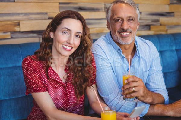 Cute paar vergadering cafe drinken sinaasappelsap Stockfoto © wavebreak_media