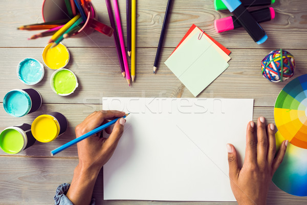 Graphic designer drawing on sheet of paper Stock photo © wavebreak_media