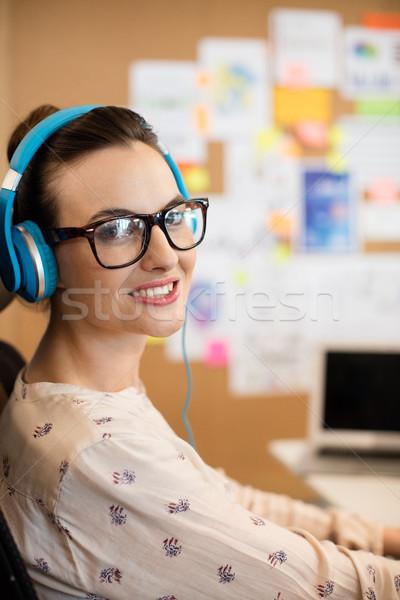 Portret uśmiechnięty projektant niebieski słuchawki Zdjęcia stock © wavebreak_media