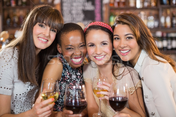 Stock photo: Portrait of happy female friends with wineglasses