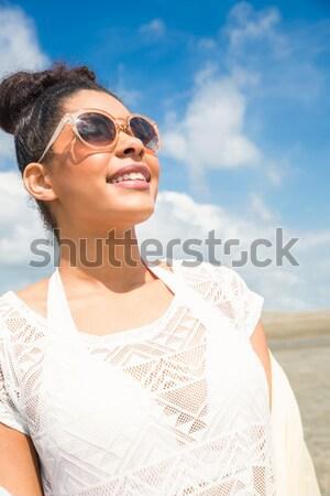 Smiling senior man relaxing at beach Stock photo © wavebreak_media