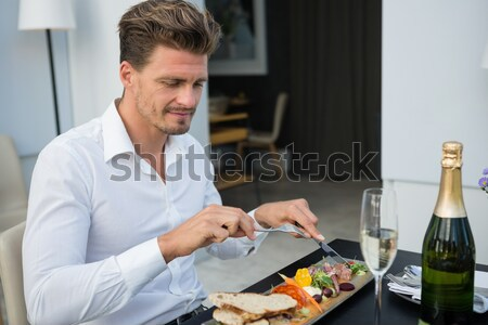 Male chef examining appetizer plates at order station Stock photo © wavebreak_media