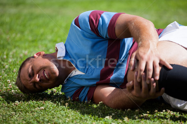 Injuerd young rugby player lying on field Stock photo © wavebreak_media
