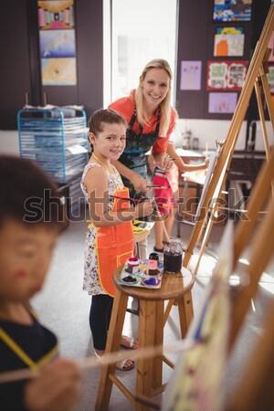Enseignants écolier dessin classe école femme Photo stock © wavebreak_media