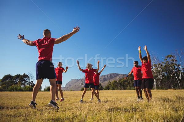 Formazione ragazzi boot campo Foto d'archivio © wavebreak_media