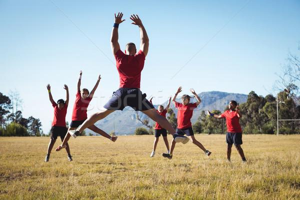 Entrenador formación ninos arranque campamento Foto stock © wavebreak_media