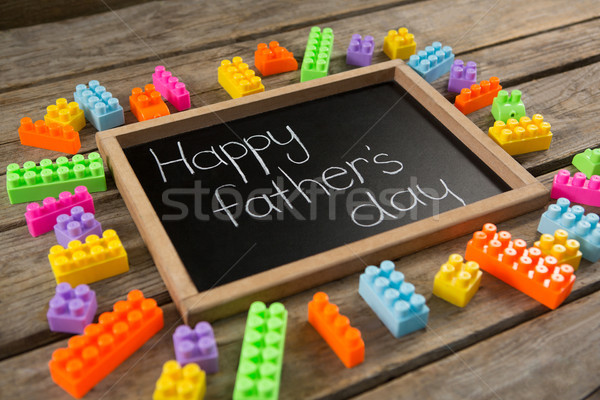Close up of happy fathers day message on slate by toy blocks Stock photo © wavebreak_media
