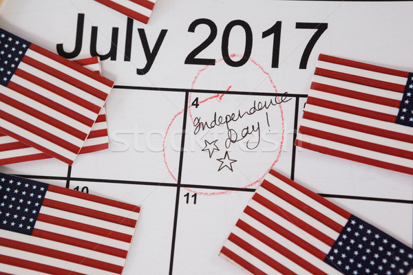 American flags with fourth of july calendar Stock photo © wavebreak_media