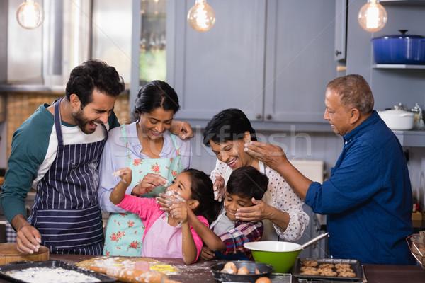 Happy multi-generation family enjoying together in kitchen Stock photo © wavebreak_media