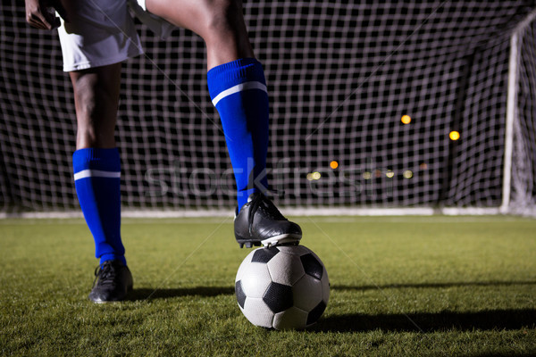 Low section of male soccer player standing with ball on field Stock photo © wavebreak_media