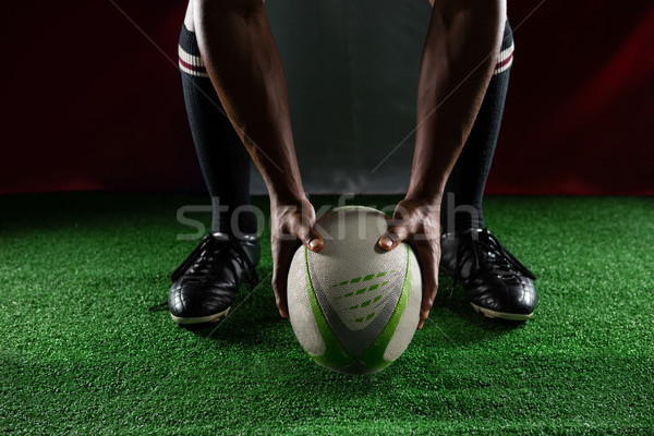 Low section of rugby player holding ball while standing against Italian Flag Stock photo © wavebreak_media