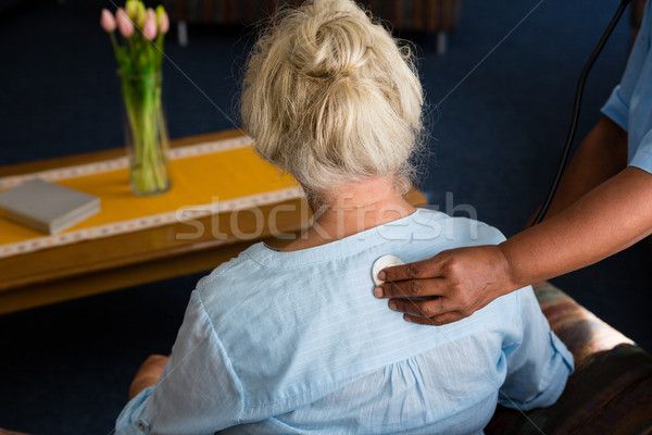 Hand of nurse examining patient in retirement home Stock photo © wavebreak_media
