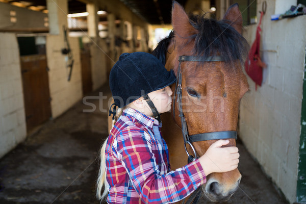 Girl kissing the horse Stock photo © wavebreak_media