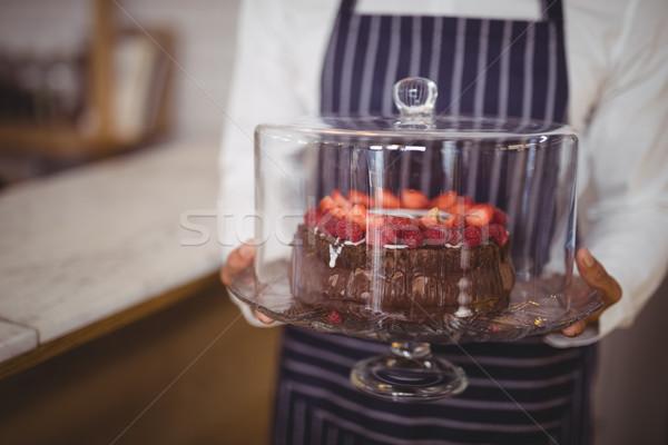 Midsection of waiter holding fresh cake on glass cakestand Stock photo © wavebreak_media