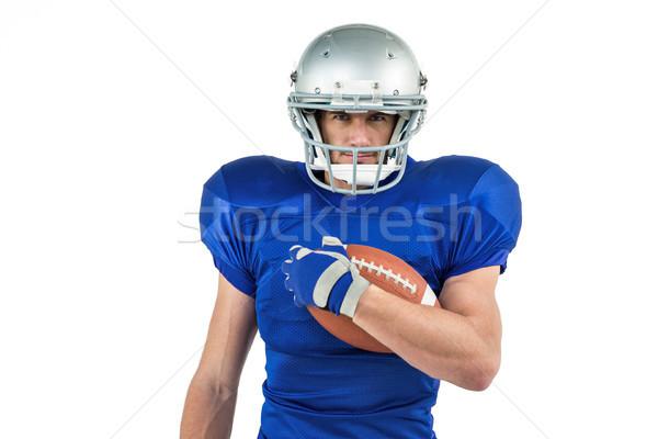 Portrait of American football player holding ball Stock photo © wavebreak_media