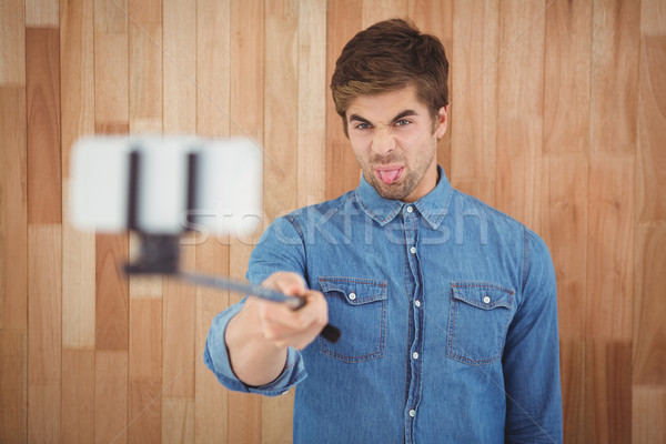 Hipster sticking out tongue while taking selfie Stock photo © wavebreak_media