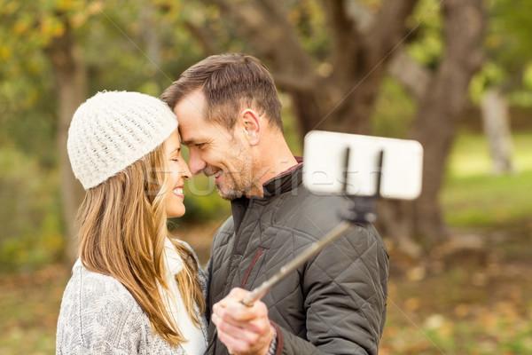 Smiling young couple taking selfies Stock photo © wavebreak_media