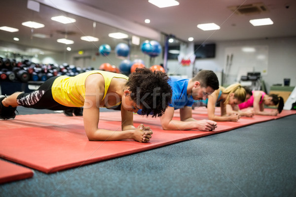 Fit people working out in fitness class Stock photo © wavebreak_media