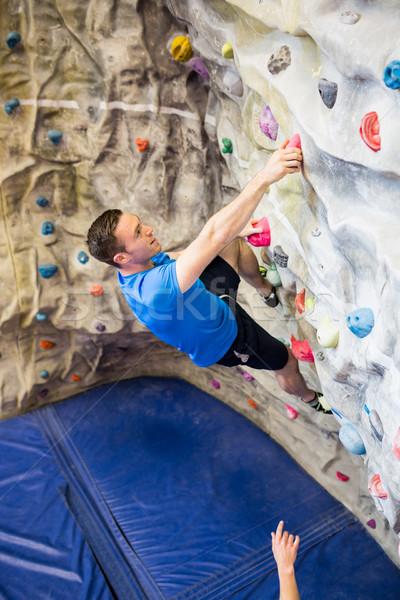 Uygun adam kaya tırmanışı spor salonu kadın Stok fotoğraf © wavebreak_media