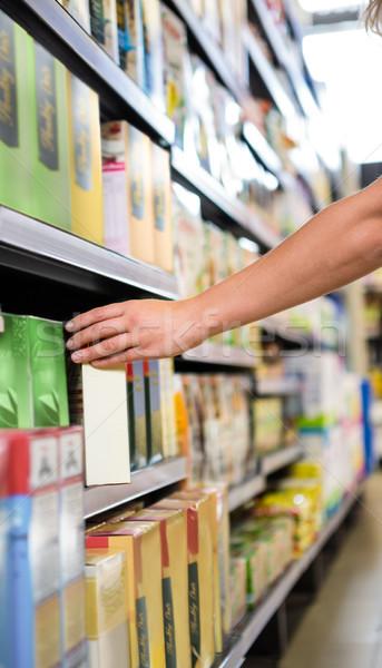 изображение женщину окна шельфа супермаркета Сток-фото © wavebreak_media